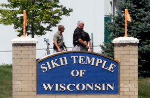 Officials gather near the Sikh Temple in Oak Creek in Wisconsin